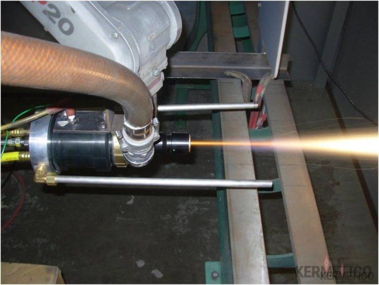 The Kermetico STI High Velocity Thermal Spray Gun Spraying Titanium Coating in the Air