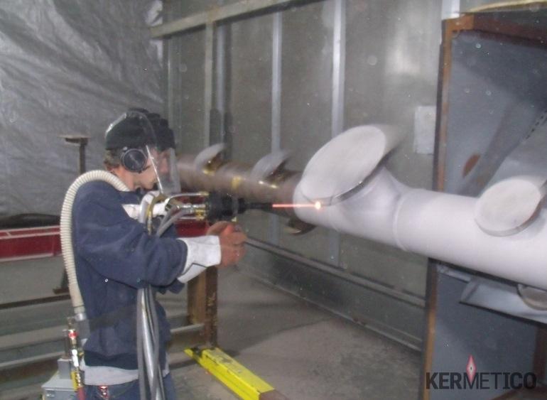 Spraying h2s resistant coating onto a Manifold with the Kermetico HVAF AK-HH Handheld Gun